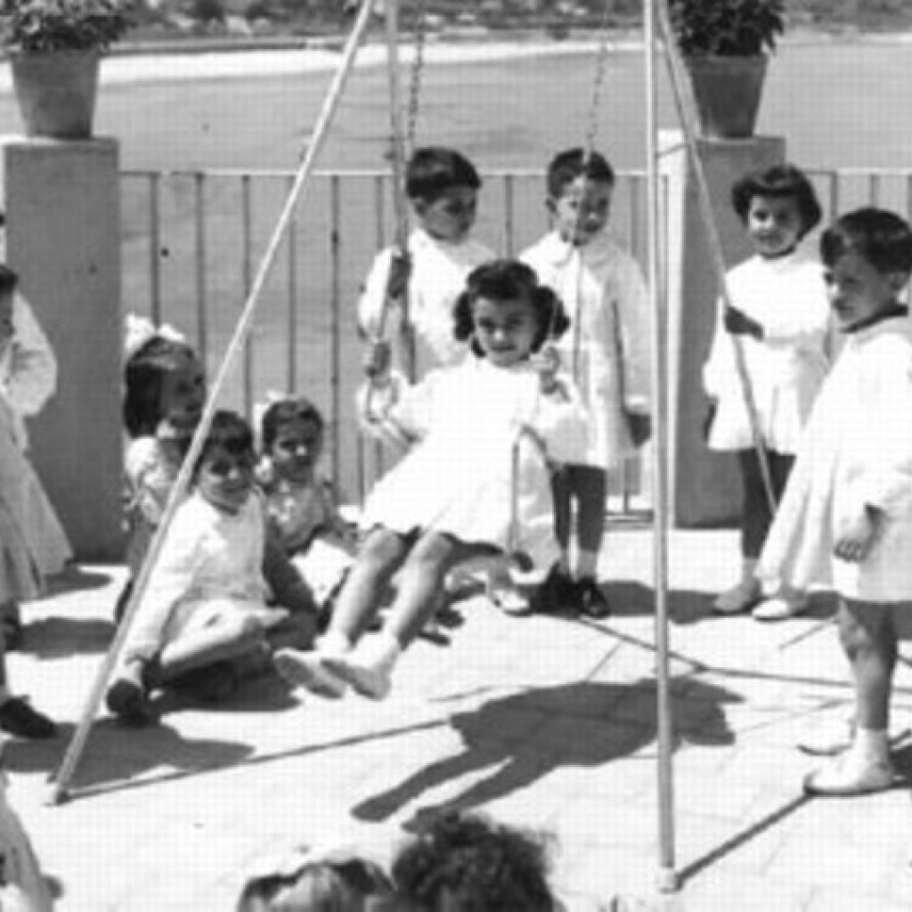 Antique photo of the Collegio di Maria di Cefalù terrace and swing with the children